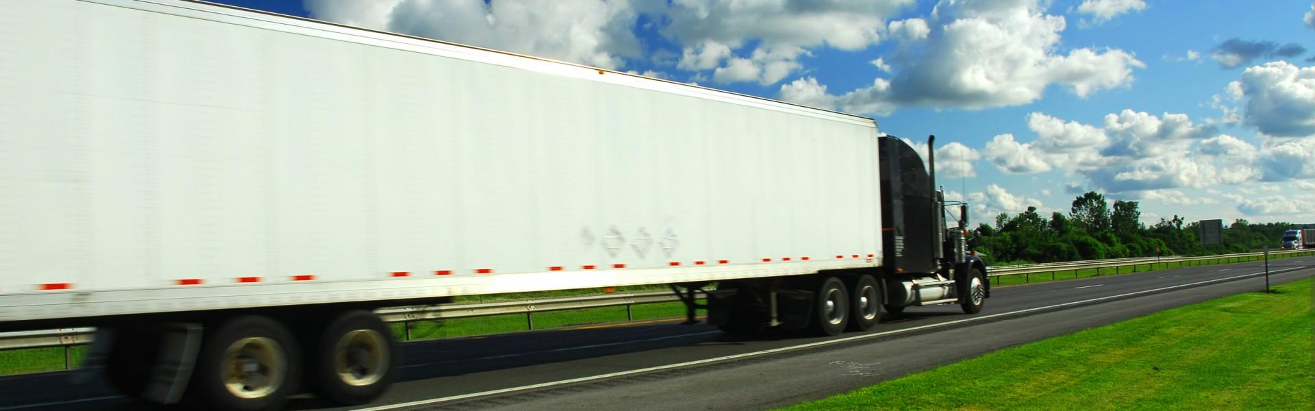 bigstock-Fast-Moving-Truck-664261-1920x600
